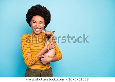pretty woman in black pants holding puppy stock photo © acidgrey