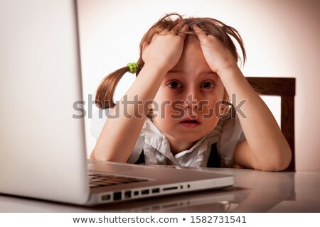 unhappy girl with laptop computer stock photo © dolgachov