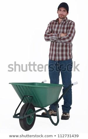 Handlowiec stałego za taczki budynku człowiek Zdjęcia stock © photography33