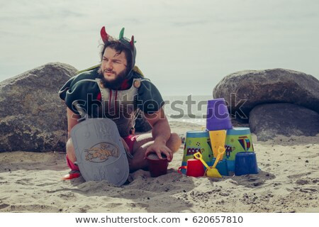 Sandcastle with a sword Stock photo © elxeneize