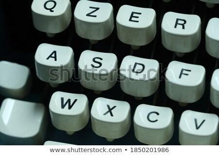 Risk on Old Typewriter's Keys. Stock photo © tashatuvango
