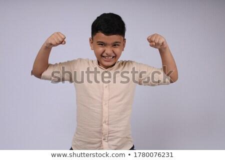 smart boy enjoys posing  Stock photo © meinzahn