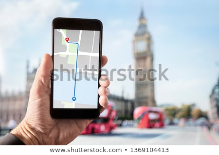 Сток-фото: Hand Holding Smartphone With City Guide In London