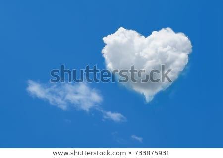 Heart shaped cloud on blue sunny sky. Stock photo © photocreo