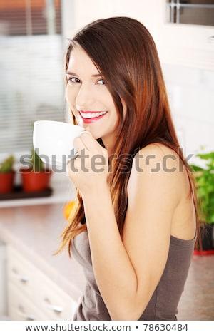 Konyha nő teáscsésze házimunka lány ház Stock fotó © racoolstudio