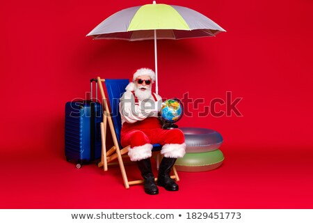 mature man in costume of traveler holding old globe stock photo © hasloo