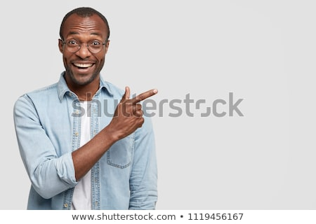 portrait of a laughing african man over white background stock photo © deandrobot