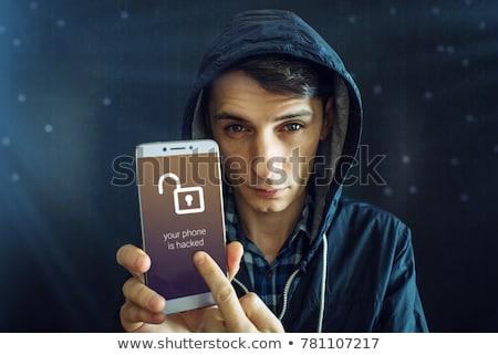 Ladrón acceso robado teléfono móvil negro pie Foto stock © AndreyPopov
