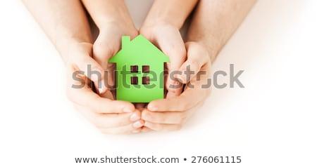 homem · mãos · papel · casa · quadro - foto stock © dolgachov