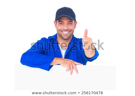 Handsome mechanic holding blank placard Stock photo © wavebreak_media