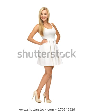 Aranyos nő áll trendi fehér ruha portré Stock fotó © deandrobot