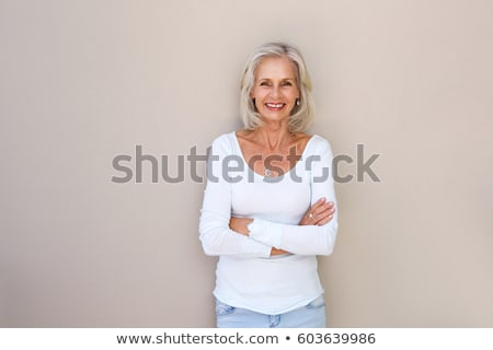 Confident mature woman outdoor wall stock photo © roboriginal