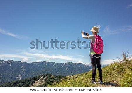 woman taking picture of beautiful nature grassland lanscape stock photo © stevanovicigor