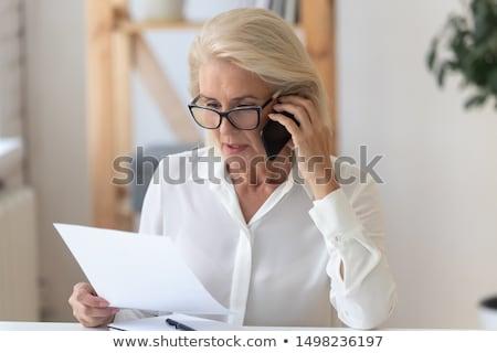 Konsantre iş kadını gözlük gri güzel Stok fotoğraf © deandrobot