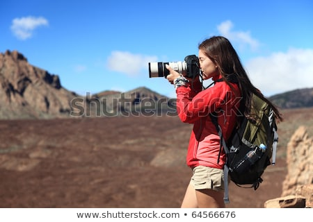 young pro photographer with digital camera stock photo © lightpoet