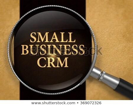 small business crm through lens on old paper stock photo © tashatuvango