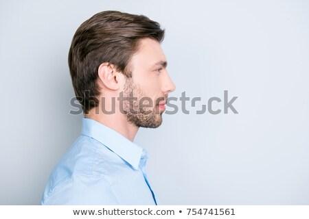 Calm man profile over gray background Stock photo © ozgur