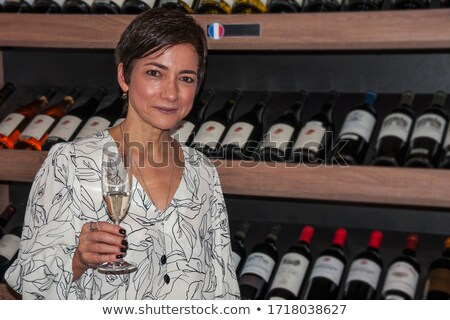 Famous woman holding glass of champagne Stock photo © deandrobot
