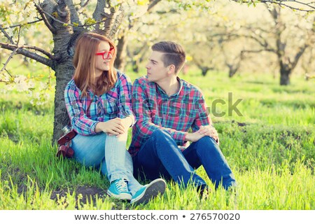 young teen couple in the spring blossom apple trees garden stock photo © massonforstock