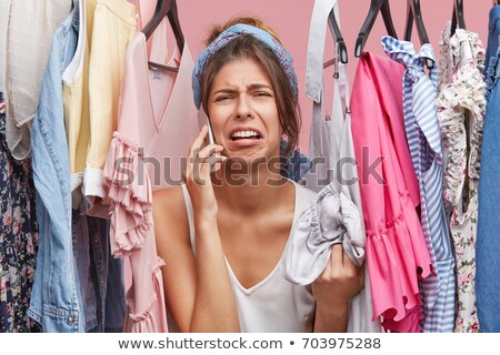Stock photo: Young pretty sad woman has nothing to put on