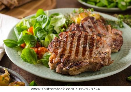 cerdo · chuleta · tabla · de · cortar · hueso - foto stock © digifoodstock