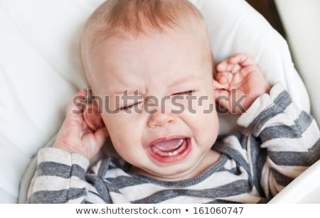 Boy hurting his ear Stock photo © bluering