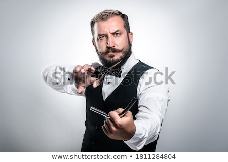 Man holding razor over gray background Stock photo © deandrobot