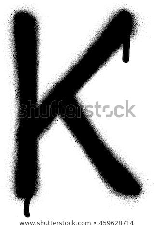 sprayed k font graffiti with leak in black over white stock photo © melvin07