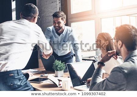 üzlet megállapodás megbeszélés szemtől szembe citromsárga iroda Stock fotó © Lightsource