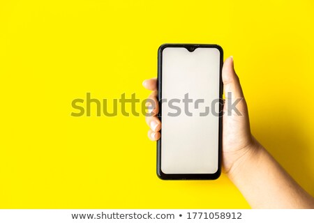 yellow mobile phone in focus stock photo © giulio_fornasar