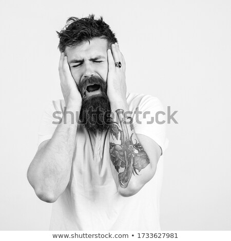 portrait of an angry hipster guy shouting on camera stock photo © deandrobot
