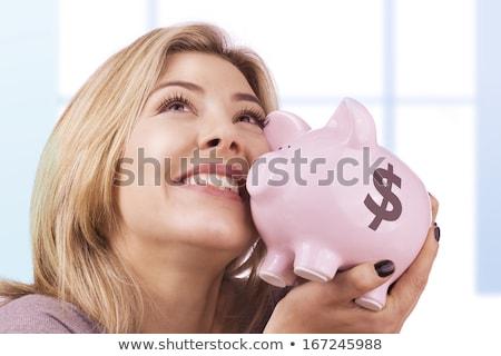 Businesswoman cuddles piggy coin bank Stock photo © stevanovicigor