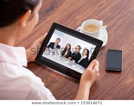 Businessmen Looking At Woman Holding Digital Tablet Stock photo © AndreyPopov