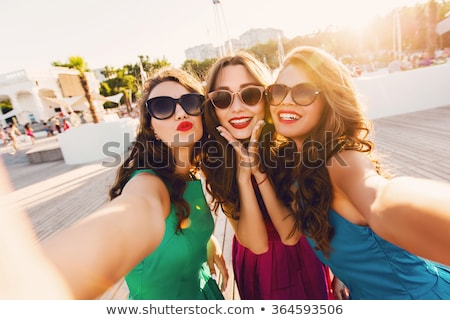 womens taking selfie on mobile phone stock photo © wavebreak_media