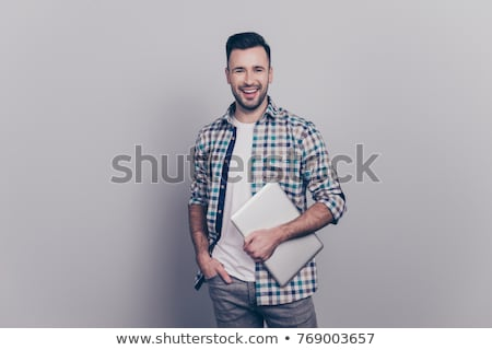 Stylish handsome bearded businessman looking at camera  Stock photo © LightFieldStudios