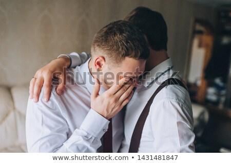 Jovem caucasiano noivo choro terno cerimônia de casamento Foto stock © RAStudio