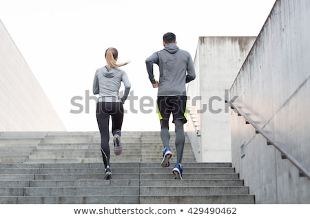 Man and woman on stairs together Stock photo © IS2