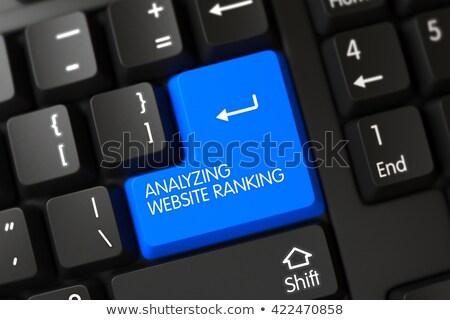 Blue Analyzing Website Ranking Keypad on Keyboard. 3D. Stock photo © tashatuvango