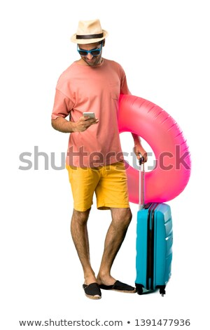 man standing on floating suitcase Stock photo © IS2