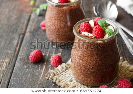 Csokoládé magok puding tej reggeli desszert Stock fotó © joannawnuk