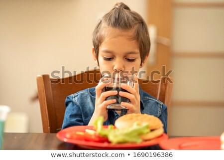 Küçük erkek içme soda yeme cheeseburger Stok fotoğraf © RAStudio