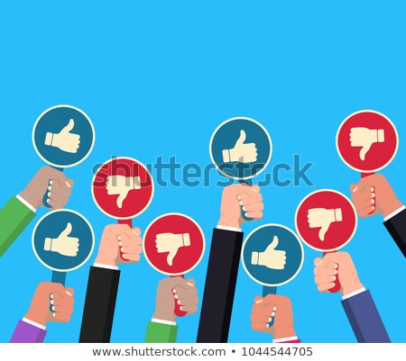 Hand holding Thump Up and Thumbs down paddle. Feedback concept. Hands rising signs with Like inscrip stock photo © Andrei_