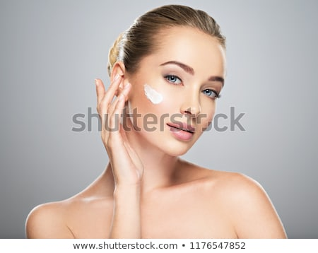 Beauty portrait of magnificent woman with healthy skin applying  Stock photo © deandrobot