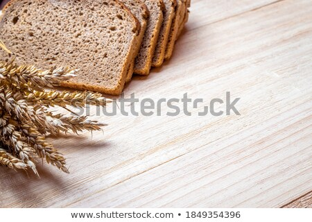 French crusty bread, isolated on a wooden plank Stock photo © FreeProd