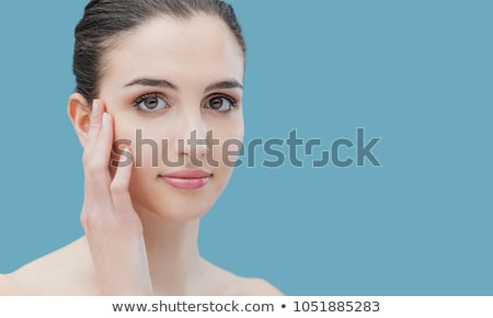 Beautiful woman caressing her face Stock photo © stokkete