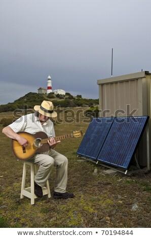 Férfi ül zsámoly elektromos gitár portré kalap Stock fotó © IS2