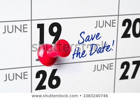 wall calendar with a red pin   june 19 stock photo © zerbor