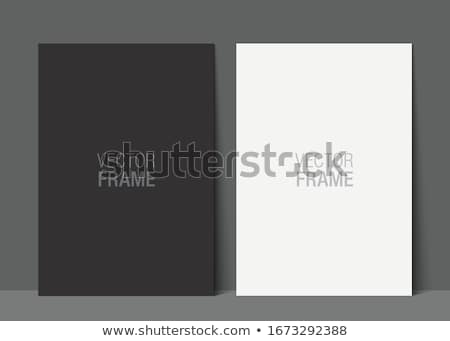 Elegant and minimalistic picture frame standing on gray wall Stock photo © adamr
