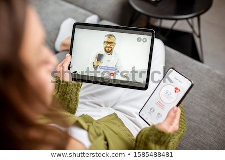 Cardiologist in telemedicine concept with heart beat Stock photo © Elnur