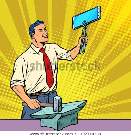 üzletember kovács okostelefon üllő kütyük technológiák Stock fotó © studiostoks